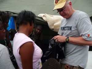 Distributing rice at Jacmel tent camp - one cup at a time