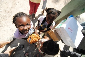 children at les cayes orphanage receiving toys