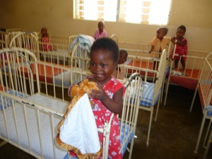 Little girl with donated toy