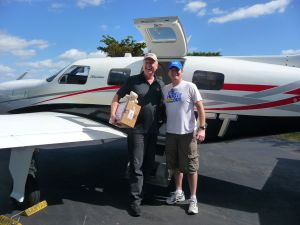 (L) Rich Pickett and Brandon Campbell departing Florida  | (R) Flying into Jacmel, Haiti