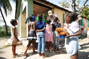 handing out toys at haitian orphanage